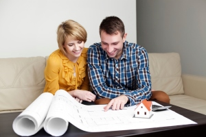 10.13.14 Millennial couple with house plans
